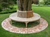 Hardwood tree seat and brick detail paving in rear garden