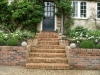Steps framed with stone balls on each side to complement planted balls