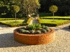 Raised circular brick planter