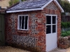 Reclaimed brick and flint summerhouse