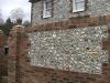 Knapped flint and brick boundary wall