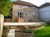 Oak sleeper retaining walls and steps - Sandstone paving – Mixed Planting scheme