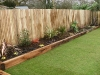 Raised New Oak planters with architectural planting