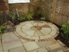 2m Mint Fossil circle with monolith water feature.