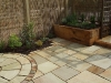 New Oak sleeper herb planters with Indian Stone Mint Fossil paving.