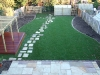 Raised Indian stone Mint Fossil terrace and path and hardwood deck.
