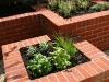 Interlocking raised brick herb planters.