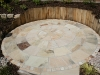 Large 4m Indian stone Mint Fossil circle with New Oak sleeper retaining wall.