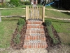 Knapped flint and brick steps edged with Lavender
