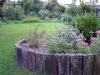 Raised sleeper border planted with seasonal perrenial planting