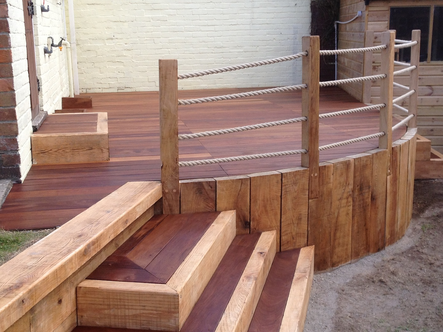 Wooden garden features garden design pergolas decking for Garden decking features