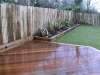 Corner hardwood deck using oak sleeper retainer
