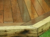 Mitred joints of sleeper retainer and hardwood deck boards