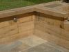 Oak retaining wall with half sleeper coping