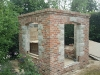 Outer brick & stone walls completed ready for roof installation