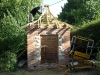 Second timber roof section being installed to create curved roof shape