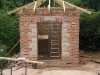 First timber roof section, door and window frames in place