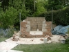 Outer rustic brick & stone walls, approximately half way through construction