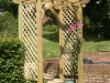 Timber archway constructed using planed tanalised timber components with trellis side panels