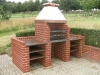 Custom Barbeque, brick built walls, granite worktops and shelves, with stainless steel grills & bespoke copper smoke hood
