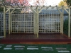 Custom made softwood pergola with trellis panels