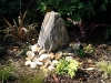 Monolith water feature with rocks and cobbles