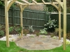Planed timber softwood pergola with Millstone circle patio