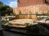 Patio area in centre of garden, eliminating the requirement for a lawn