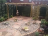 Paving and aggregate surfaces, no lawn to maintain, all timber pre-treated with preservative