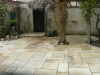 Low maintenance patio area, using natural stone which will not fade like a replica stone product will