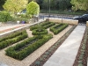 Traditional English knot garden planting, formal shapes of box hedging, planted internally with perennial group planting