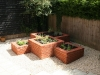 Interlocking squares, raised brick built planters