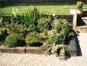 Low level reclaimed sleeper retained border