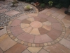 Central sandstone circle with matching stone sett edging
