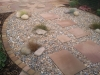 Scree area edged with sandstone setts to match the patio, providing a solid edging to separate pebbles and border mulch