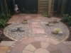 Central scree area providing low maintenance surface between patio surfaces