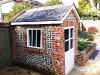 Completed Summerhouse - Reclaimed brick with flint detailing, Reclaimed slate roof