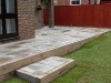 Step section built with new oak sleeper riser with stone paving treads