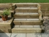 Step section built with new softwood sleepers with stone paving treads