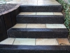 Step section built with reclaimed sleeper risers with stone paving treads
