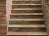 Step section built with brick risers and stone paving treads