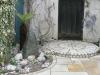 Single step onto paved circle built with stone sett riser