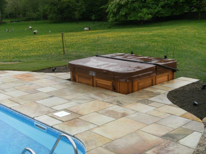 Garden design swimming pool sandstone hampshire for Garden swimming pool uk