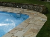 Pool corner, slabs cut with specific rounded coping on edge