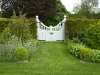 This beautiful pair of gates provides a focal point in the garden.
