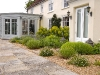 Yorkstone pathway complemented by planting against house