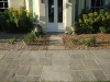 Traditional York Stone pathway leading to house entrance, framed with planting