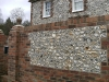 Traditional brick & flint walling around period style property