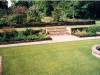 Traditional formal lawn area with higher garden level retained by sleeper walling