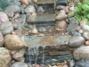 Natural stream section to create water movement dressed with slate, rocks and cobbles